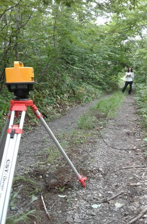Levels along a survey line being taken with a self levelling laser level