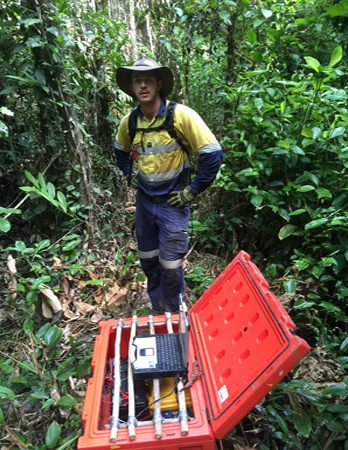 One of our Perth based staff members in the jungle with the collection equipment in a carry box.